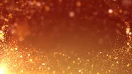 دانلود فوتیج جریان پارتیکل های طلایی در نور نارنجی