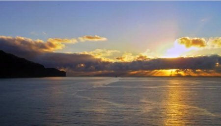 دانلود فوتیج تایم لپس طلوع خورشید بر فراز اقیانوس زیبا